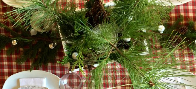 Christmas Dining Table with Plaid Tablecloth and Fresh Greenery